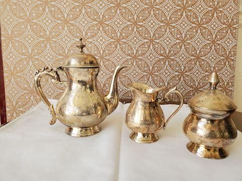 Silver plate teapot and sugar/creamer set
