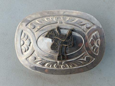 silver color cowbow saddle belt buckle by Chambers