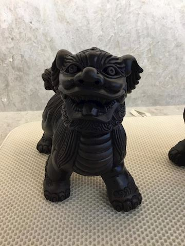 two asian pug figurines