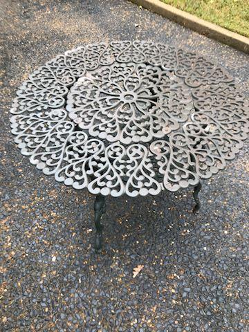 109.  Yard.  Cast Iron Table
