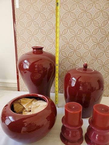 Three Maroon vessels and candlesticks