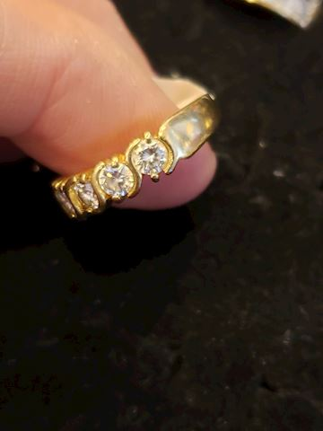 Size 7 approx .50ctw diamond 14k band