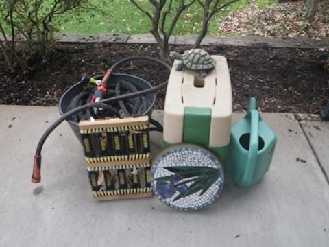 Bench, Hoses, Watering Can, and Decor