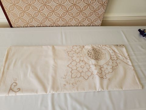 Cream and lace cutwork tablecloth