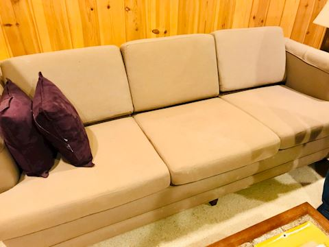 Low profile tan sofa