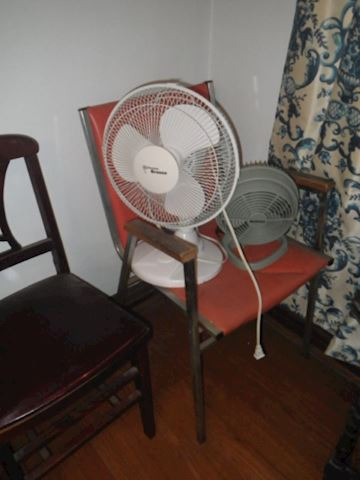 Orange Chair and Two Small Fans