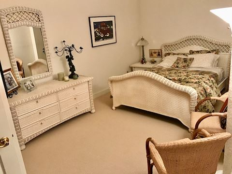 White Queen bed with end table and dresser