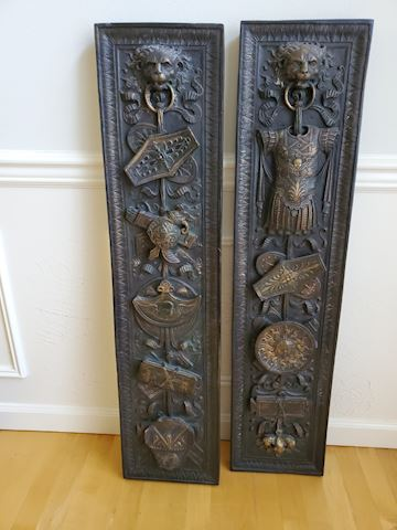 2 wood panels carved with lions holding armor