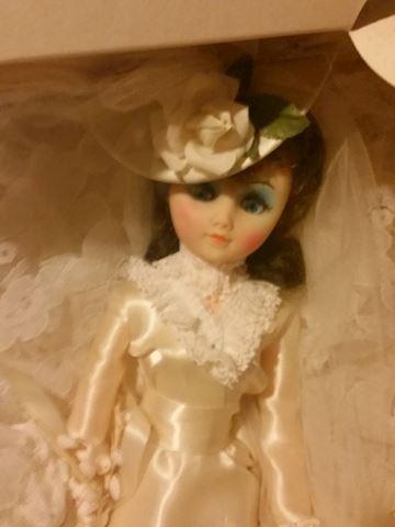 Heirloom fashion doll in real wedding dress bride