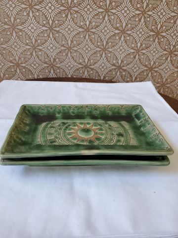 2 Rectangular dishes with sun and fish motif