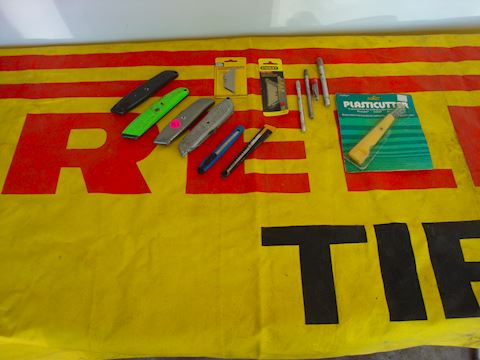 Pirelli canvas banner, box cutters Lot #153