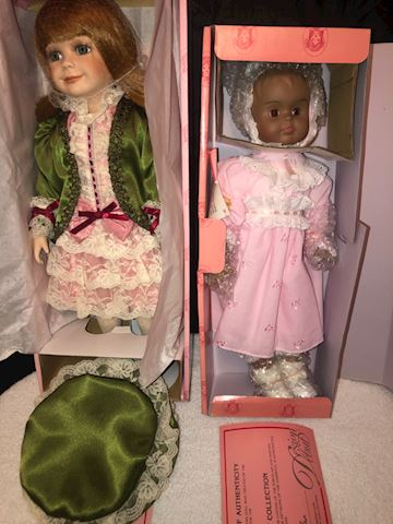 2 larger dolls