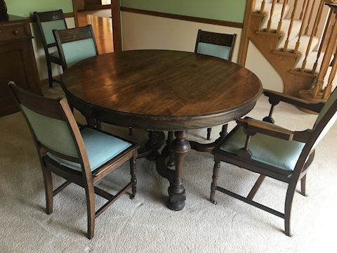 Antique dining table with 6 chairs and a leaf