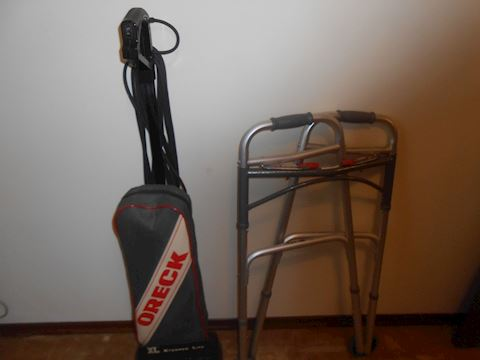 (2) Items - Oreck vacuum and walker