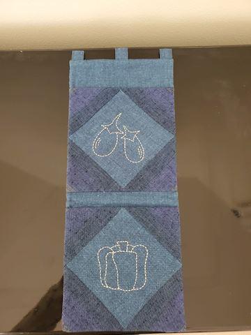 Hanging pocket holder