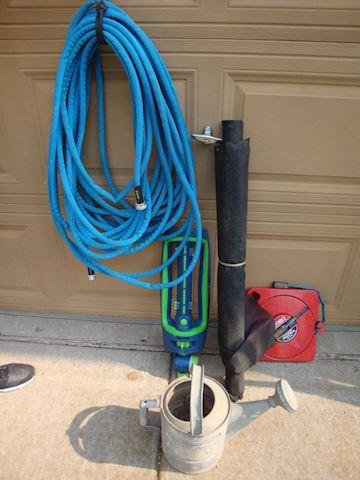sprinkler/watercan/hose & reel Lot # 48
