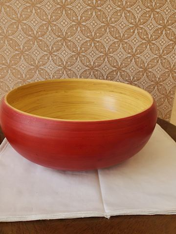 Large red wood bowl with tan interior