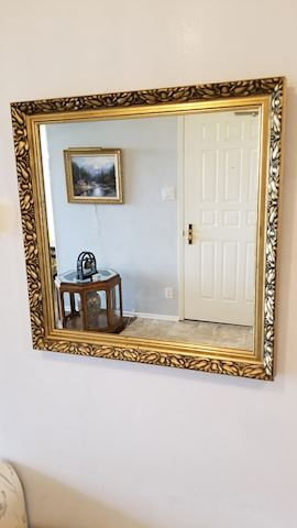 Square gold framed wall mirror