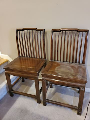 2 curved back Asian style wood chairs
