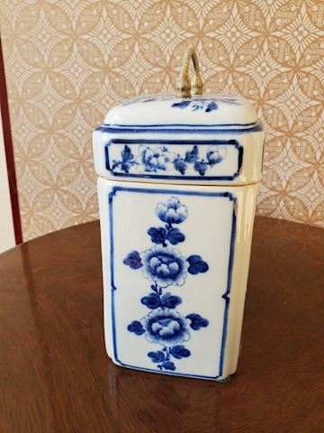 Tall blue and white porcelain box with gold handle