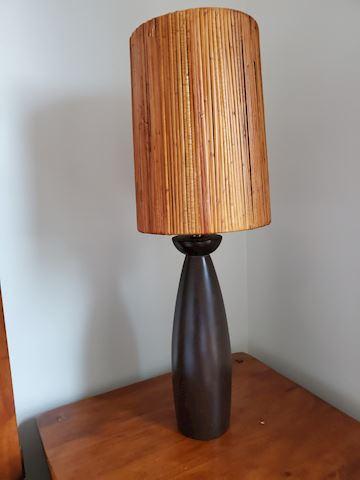 Tall wood lamp with reed natural shade