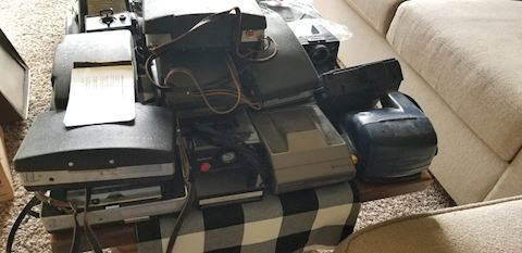 Large group of Polaroid cameras and accessories