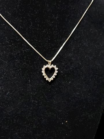 14k white gold with 16 diamonds approx .64ctw