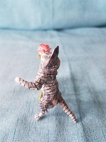 cat figurine with rose