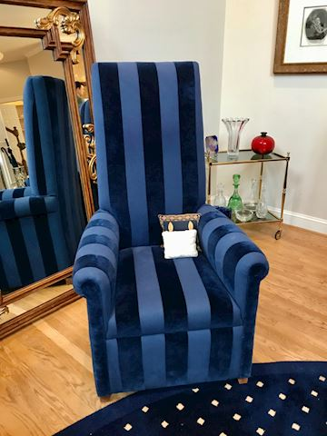 High back upholstered armchair in blue tone