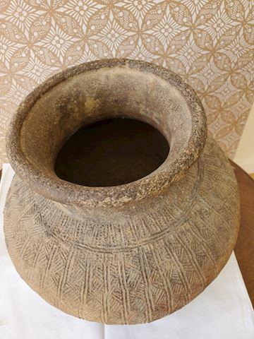 Primitive ceramic vessel with cared detail