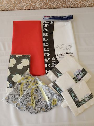Lot of napkins and plastic tablecloths