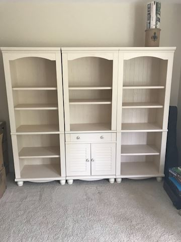 Cream color wall unit with louver cabinets