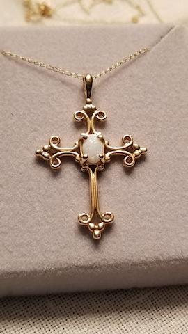 14k cross with Opal