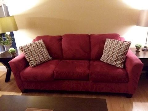 Red Upholstered Sofa & Throw Pillows