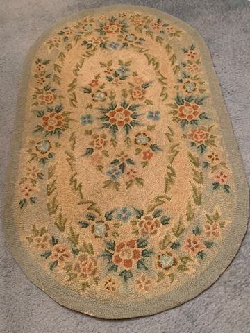 MB. 100.    Small Oval woven rug
