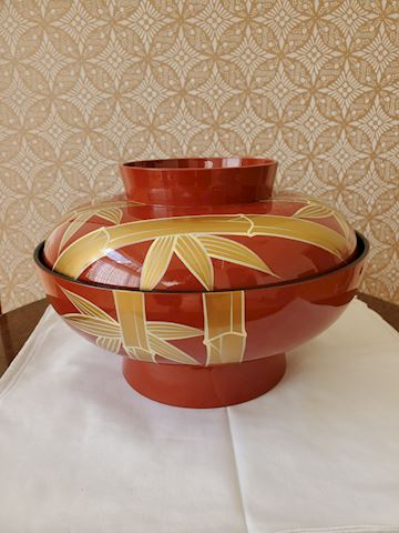 Large red lacquer rice bowl with gold bamboo