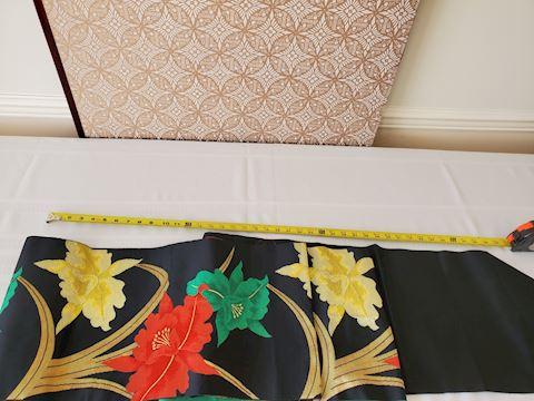 Long black with woven floral design textile