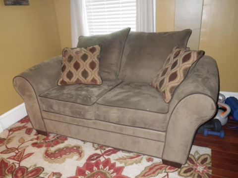 Olive Colored Loveseat with Brown Trim