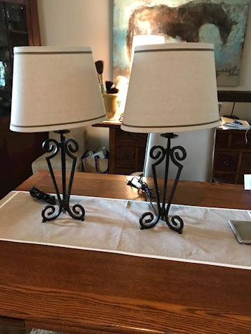 Two wrought iron lamps with oval shades