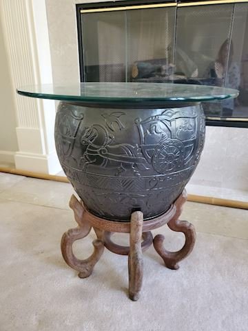 Glass top warrior motif jar side table on stand