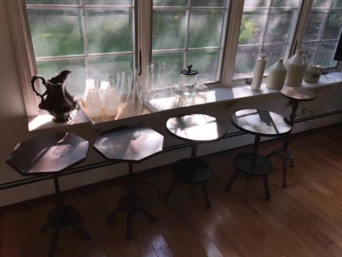 Lot 12 tables and glass lanterns