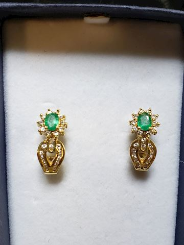 Emerald and diamond earrings in 14k