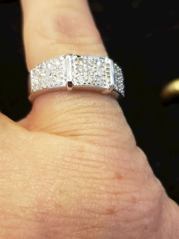 10k white gold and approximately .33ctw diamonds