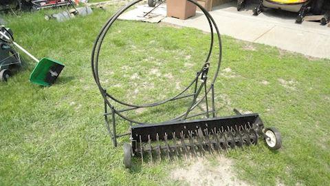 Lawn Aerator & firewood holder Lot #28