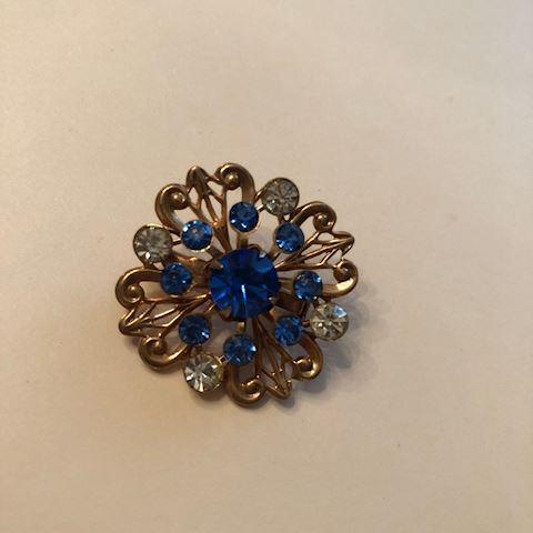 Vintage gold tone blue rhinestone brooch