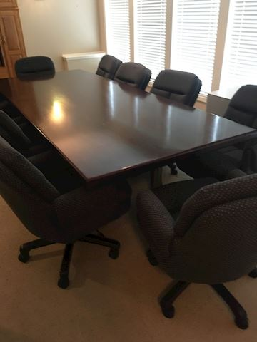10' table w/8 Fux Steel over stuffed office chairs