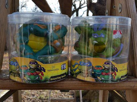 two ninja turtle bounzing buddies toys in packages
