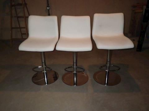 Three White Leather Barstools