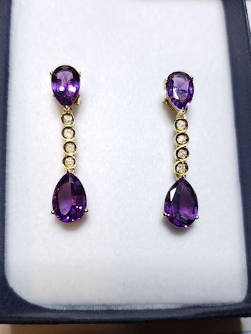 Amethyst and diamond earrings in 14k gold.