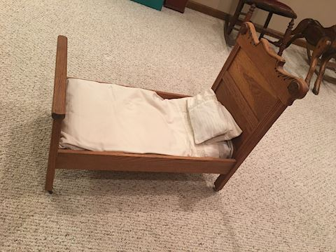 Antique wooden doll bed
